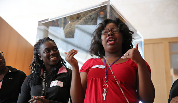 A student introduces herself during Student Chalet
