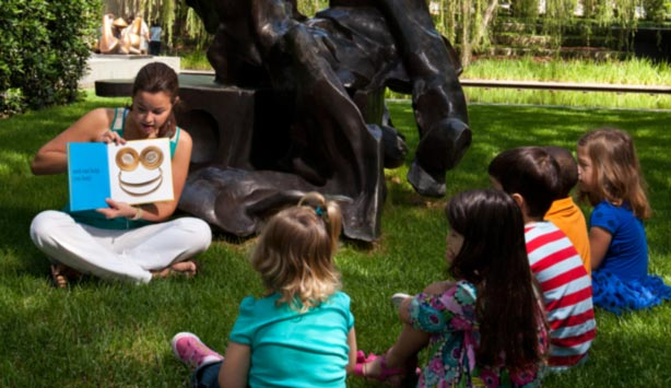 Children listen to a story in the Nasher Garden