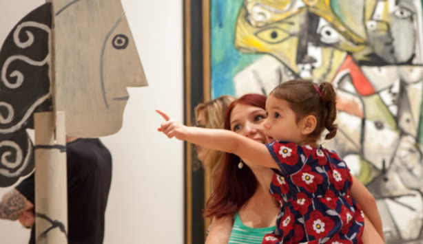 A mother and child look at a sculpture by Picasso at the Nasher.
