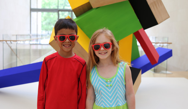 Kids in the galleries with sunglasses