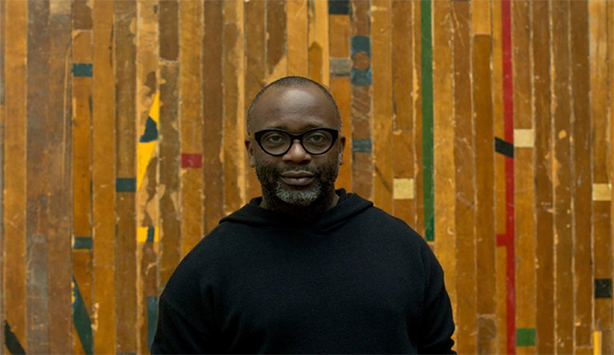 2018 Nasher Prize Laureate standing in front of a piece in the National Gallery of Art