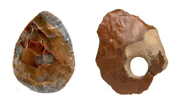 Two brown oval handaxes, the left is more textured and the right has a hole