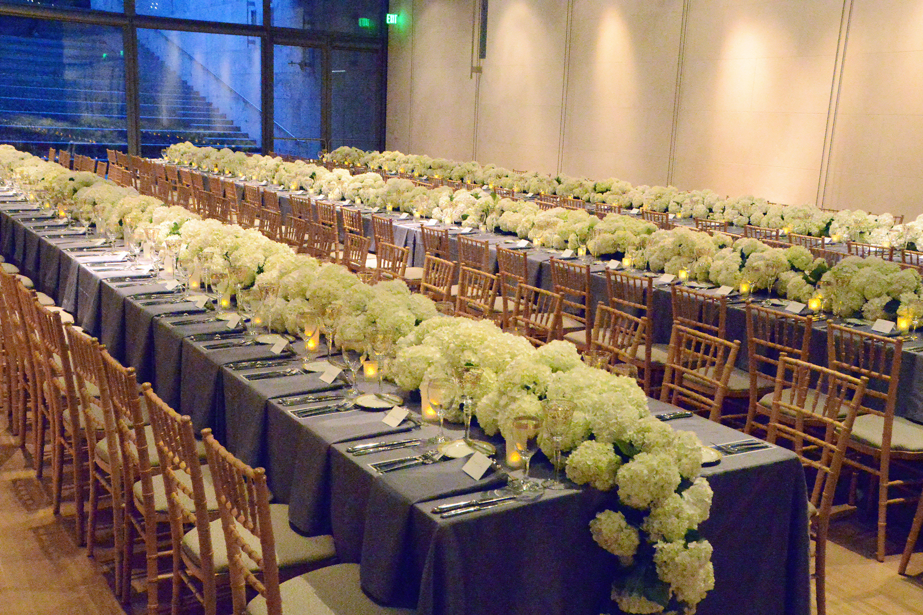 Nasher Hall with table settings and cascading flowers